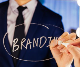 Smart business man writing the word Business on the mirror board - Branding marketing plan text letter